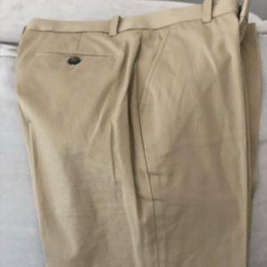Young men's khaki dress pants and button dow shirt